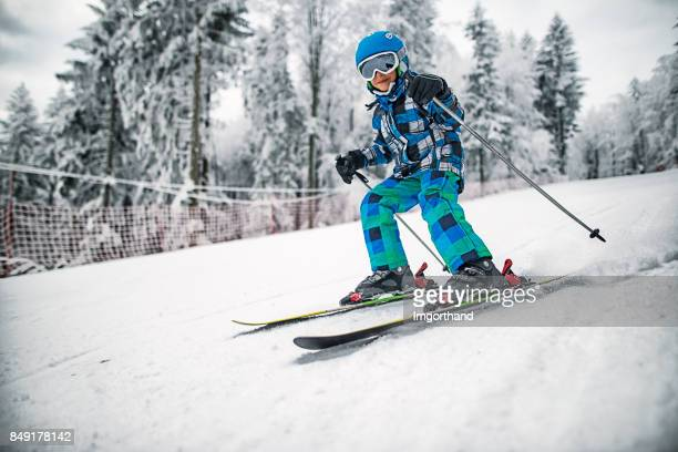 Little boy skiing on a beautiful winter day