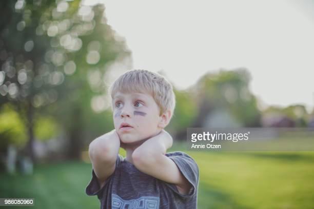 Little boy standing outside
