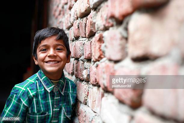 little boy standing portrait - poverty stock pictures, royalty-free photos & images