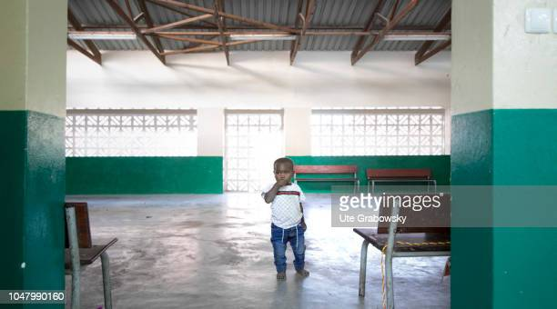 A little boy stands alone in an empty room in an orphanage on August 26 2018 in Beira Mozambique