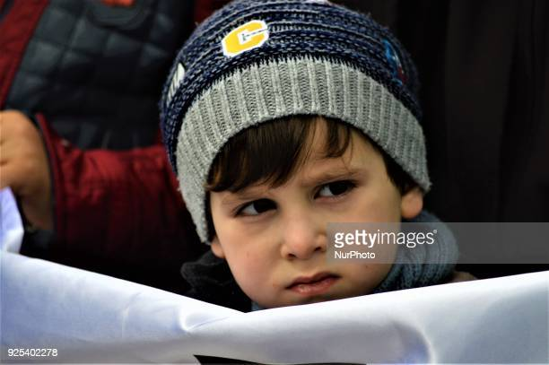 A little boy stands behind a banner as an organized group of proIslamic demonstrators makes a statement outside the main courthouse on the 21th...