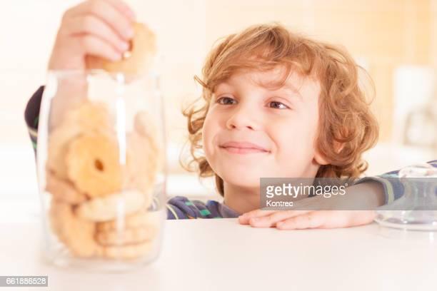 Little boy stealing cookies