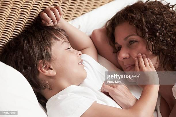 Little boy stroking mother's cheek
