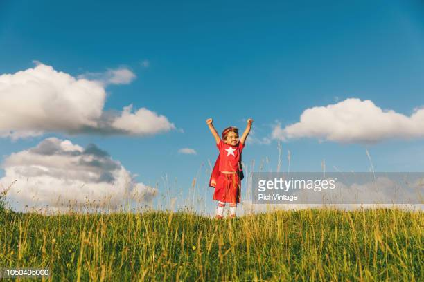 little boy superhero flying in england - cape garment stock photos and pictures