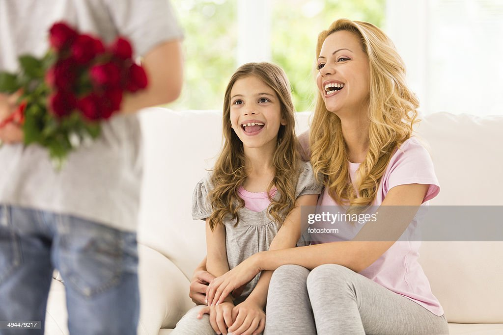 Little Boy Surprising His Mother And Sister With Red Roses ...