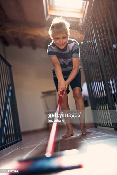 little boy sweeping - sweeping stock pictures, royalty-free photos & images