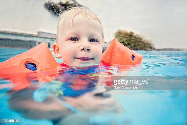 little boy swimming in the pool - armband stock pictures, royalty-free photos & images