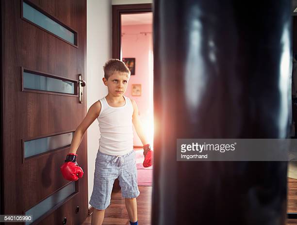 little boy training with punching bag at home - funny boxing stock photos and pictures
