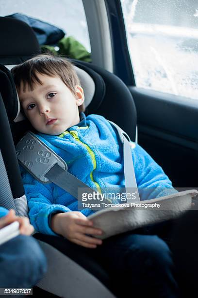 Little boy, traveling in car, feeling sick