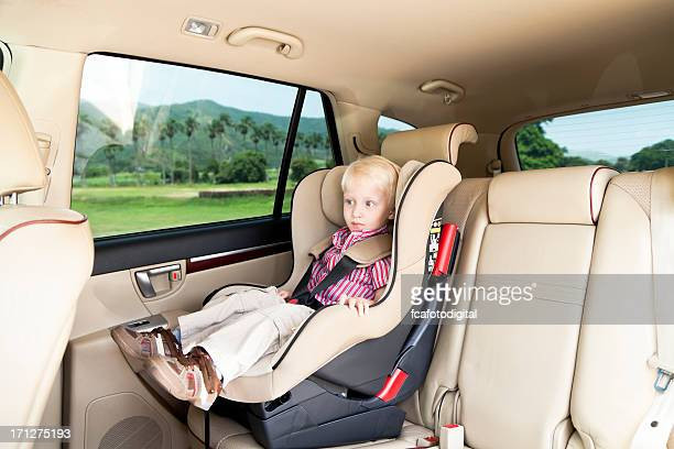 Little Boy Traveling Safely in Car Seat