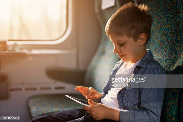 little boy travelling by train - imgorthand stock photos and pictures