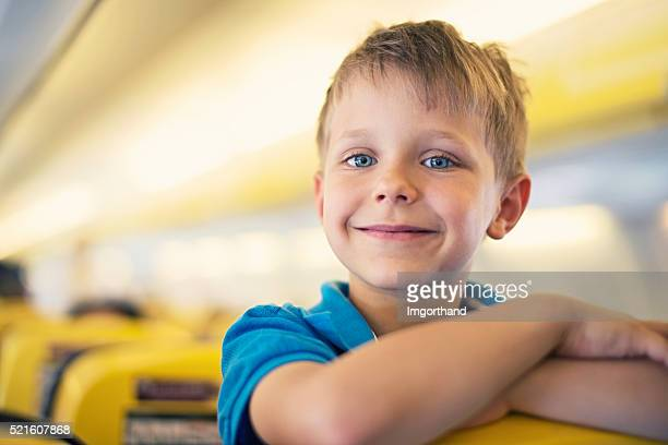 Little boy travelling in plane