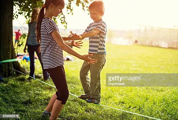 Little boy trying to walk on slackline