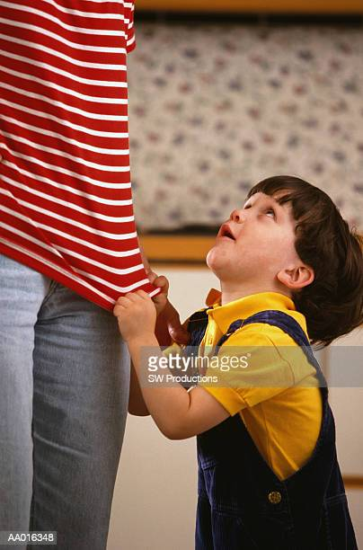 Little Boy Tugging on Mother's Shirt