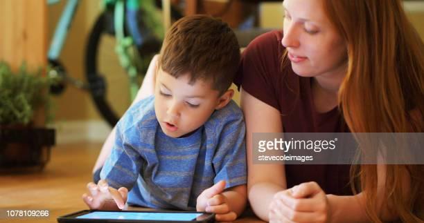 Little boy using digital tablet.