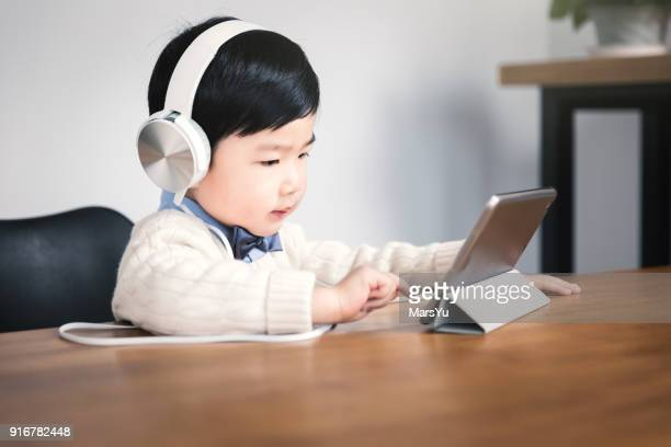 Little boy using digital tablets