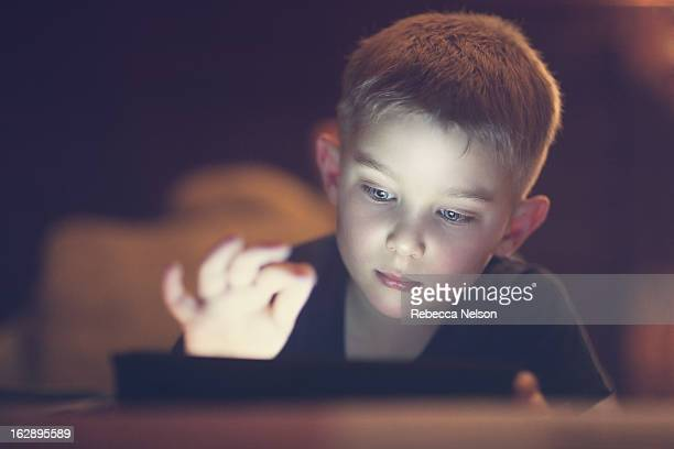 little boy using tablet - rebecca nelson stock pictures, royalty-free photos & images