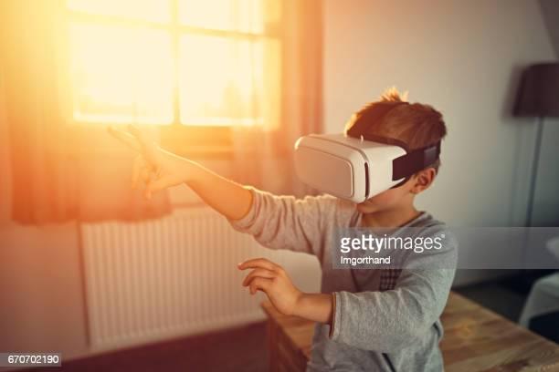 Little boy using virtual reality headset
