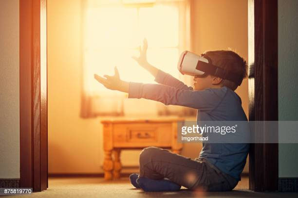 Little boy using virtual reality headset
