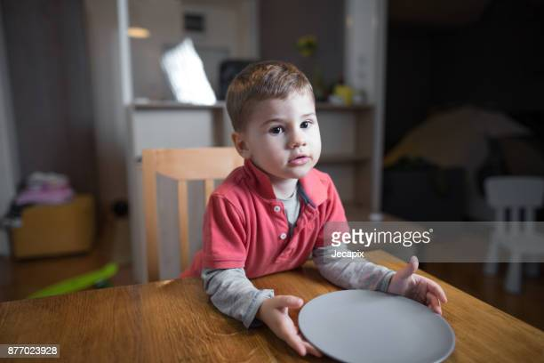 little boy waiting for his dinner - hungry stock pictures, royalty-free photos & images