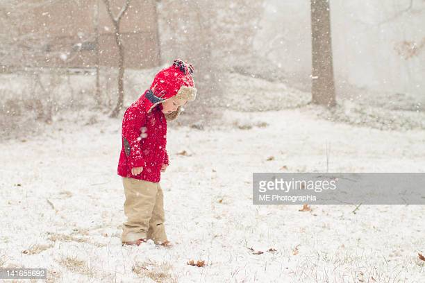 little boy walking at snow - pomona new york state stock pictures, royalty-free photos & images