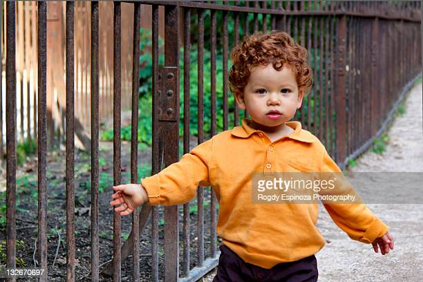 little boy walking on path - long sleeved stock pictures, royalty-free photos & images