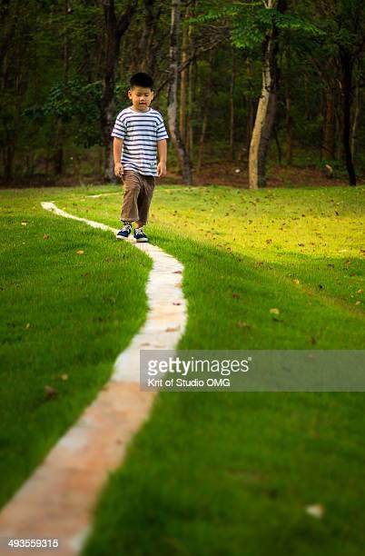 Little boy walking on the long line
