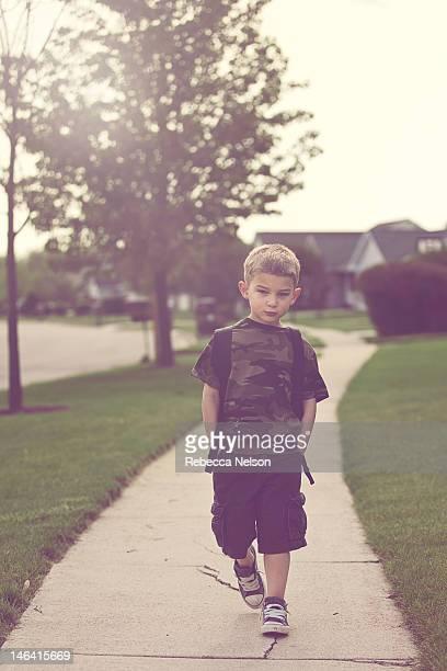 Little boy walking to school
