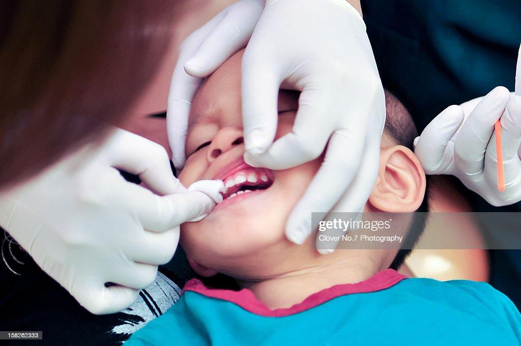 Little boy watching check teeth : Stock Photo
