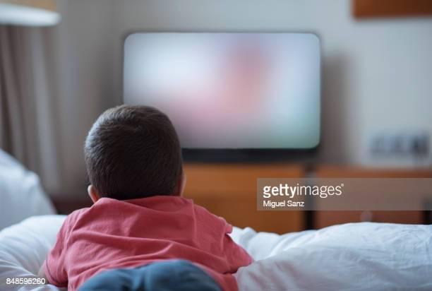 Little boy watching television