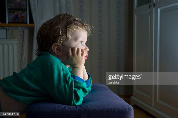 little boy watching tv - staring stock photos and pictures