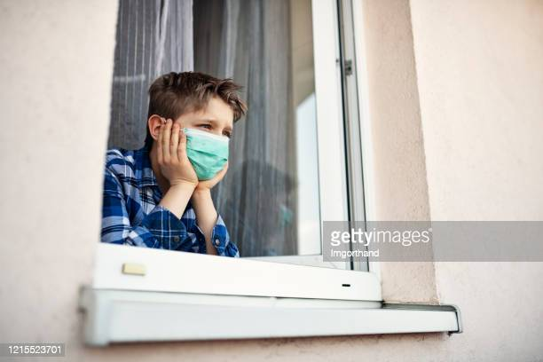 little boy wearing anti virus mask staying at home - stay at home order stock pictures, royalty-free photos & images