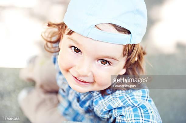 Little boy wearing blue hat