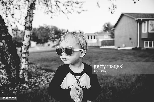 Little boy wearing funny sunglasses