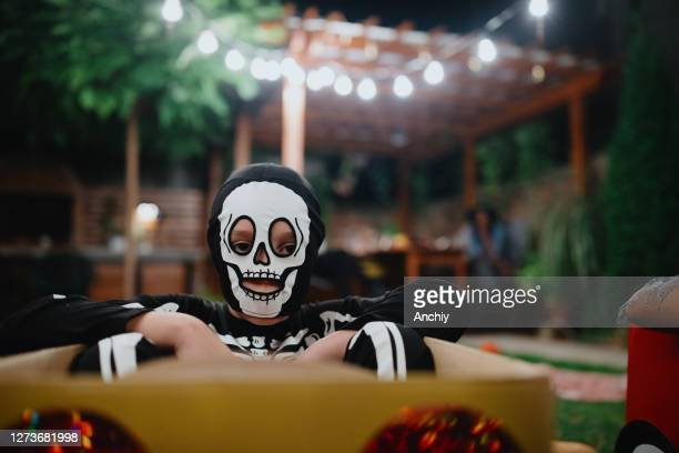 little boy wearing halloween costume and keeping social distance during outdoor halloween party - scaredastronaut stock pictures, royalty-free photos & images