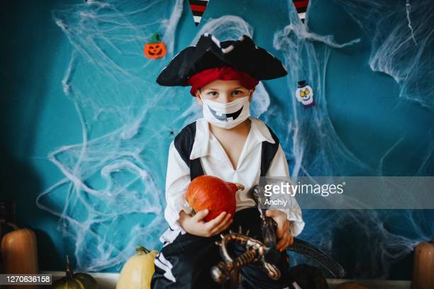 little boy wearing halloween costume and protective face mask during covid-19 pandemic - halloween stock pictures, royalty-free photos & images