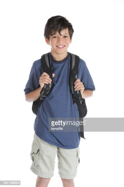 A little boy wearing his backpack ready for school
