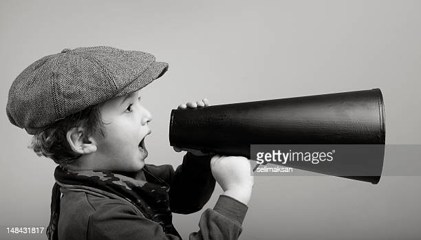 little boy wearing newsboy cap shouting with megaphone - toned image stock pictures, royalty-free photos & images