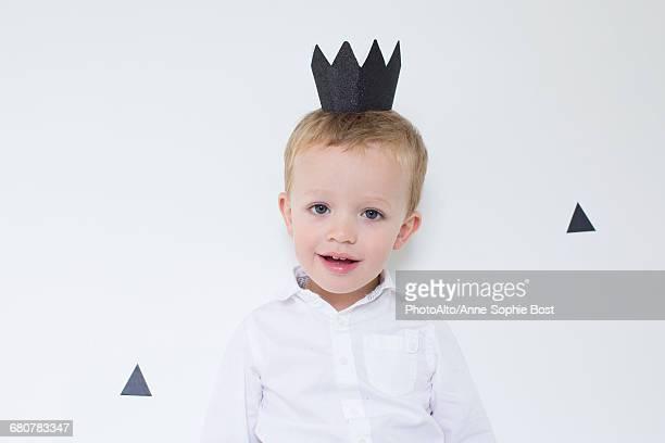 Little boy wearing paper crown, portrait