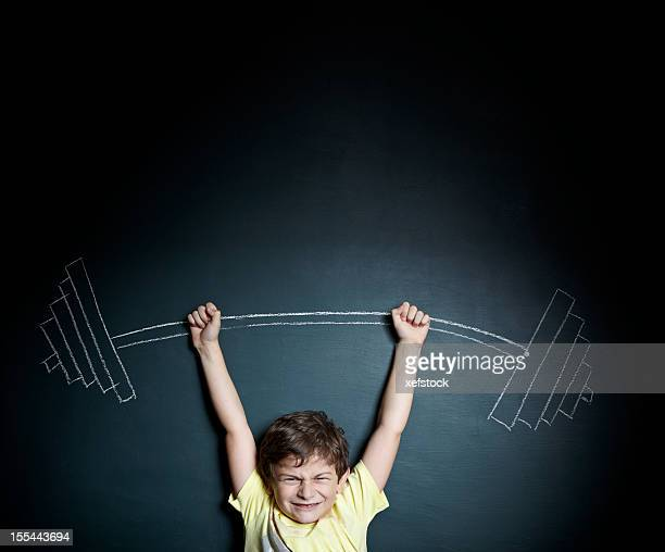 Little boy weight lifter