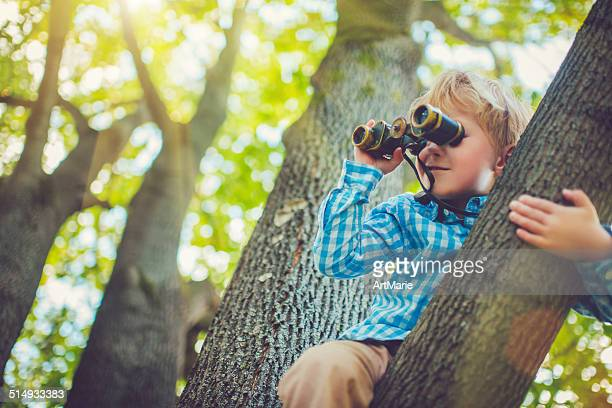 little boy with a binocular - curiosity stock photos and pictures