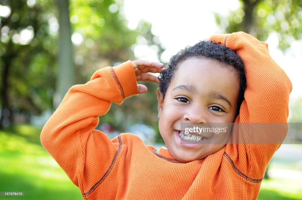 Little Boy with a Priceless Smile Outside : Stock Photo