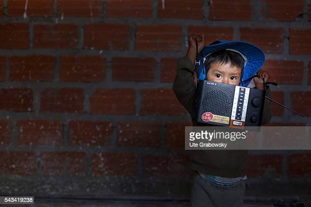 Little boy with an audio device at a construction site on April 22 2016 in Tawarchapi Bolivia
