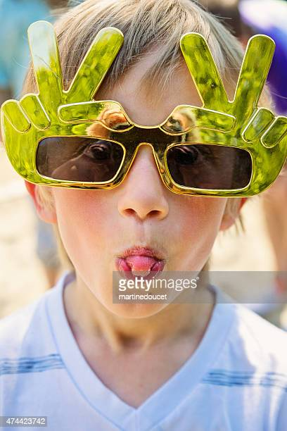 """little boy with big toy funny glasses sticking out tongue. - """"martine doucet"""" or martinedoucet stock pictures, royalty-free photos & images"""