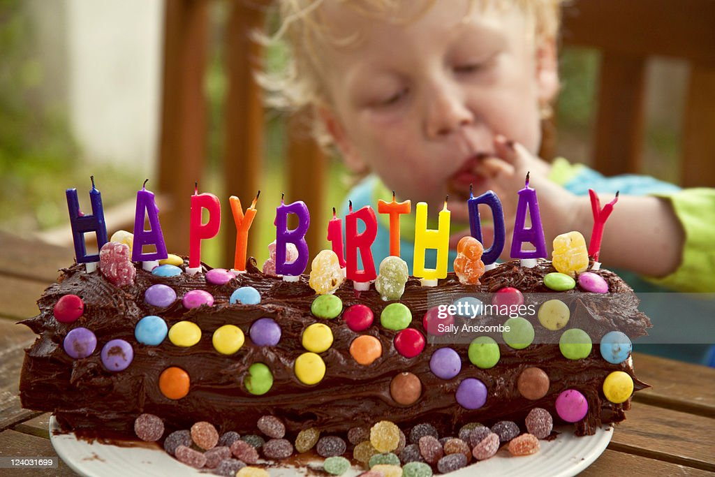 Remarkable Little Boy With Birthday Cake High Res Stock Photo Getty Images Personalised Birthday Cards Veneteletsinfo