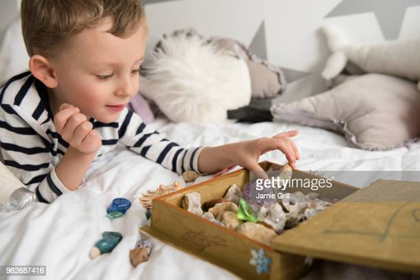 little boy (4-5) with box full of treasures - collection stock pictures, royalty-free photos & images
