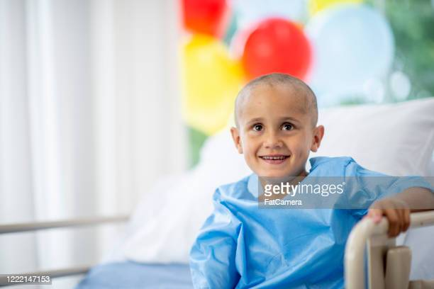 little boy with cancer in the hospital - leukemia stock pictures, royalty-free photos & images