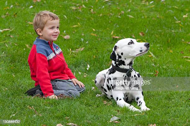 Little boy with Dalmatian