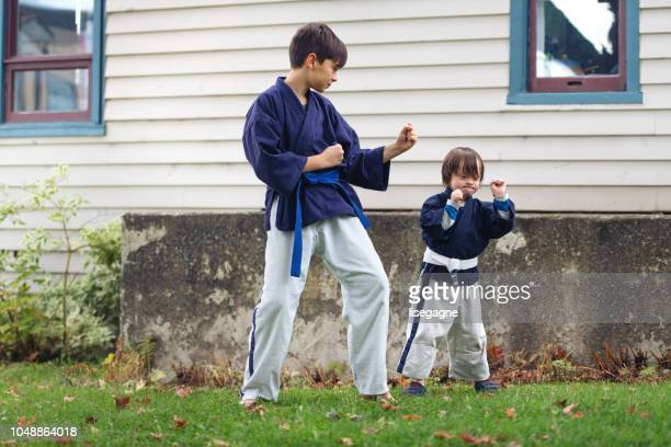 Little boy with down syndrome having activities with family