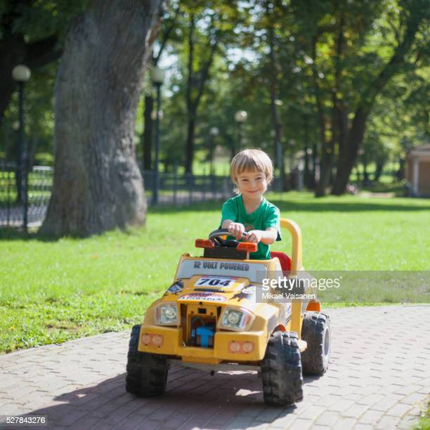 little boy with electric toy car